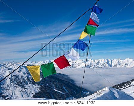Prayer flag in front of peaks