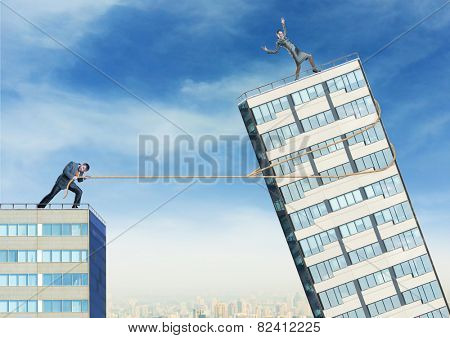 Businessman tries to push down businesswoman