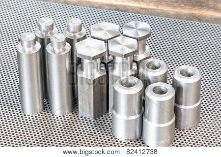Iron Details - Shafts Bolts Nuts And Cylinders. Metal Engineering.