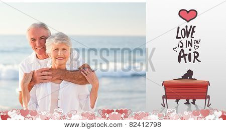 Man hugging his wife on the beach against love is in the air