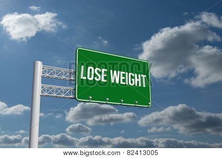The word lose weight and green billboard sign against sky and clouds