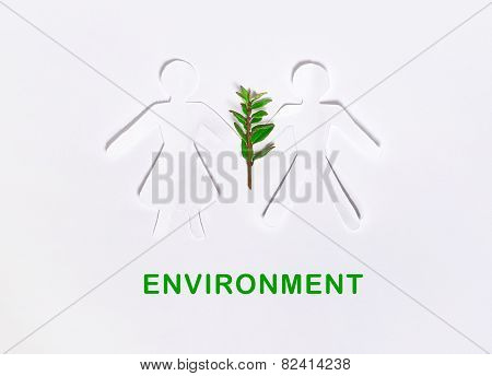 Paper dolls holding a plant with sample text, environment concept