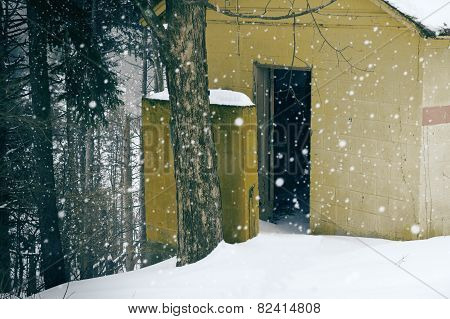 Yellow Outhouse Snowy Day