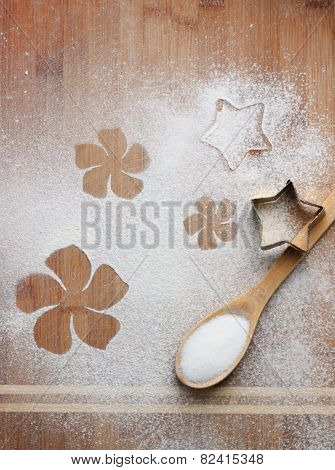 flowers on flour and wooden background