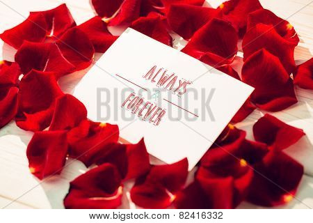 always and forever against card surrounded by rose petals
