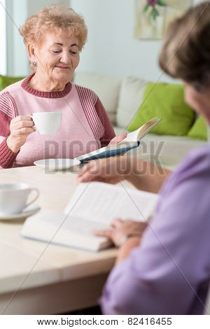 Elder Women Reading Book
