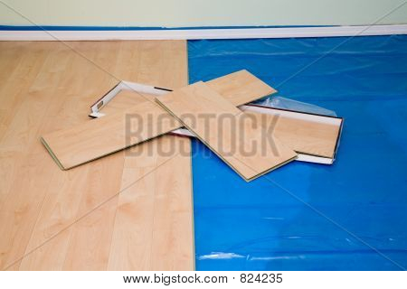 DIY project: installing maple finished laminate floor in living