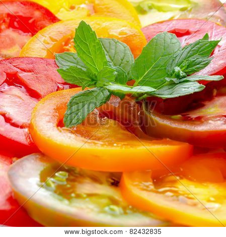 Healthy Natural Food Colorful Tomato Slices And Green  Mint, Fresh Organic Food In A Plate, Isolated