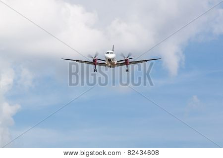 Propeller Plane Landing with Clouds