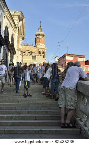 Tourists Over  The Rialto Bridge