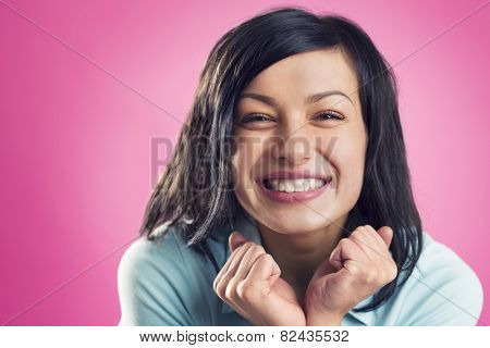 Close up portrait of happy, smiling, girl looking straight, isolated on pink background.