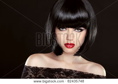Brunette Woman With Red Lips And Short Hairstyle Over Dark Background