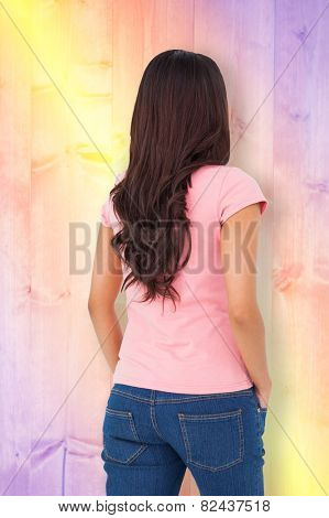 Pretty brunette stepping against yellow and purple planks