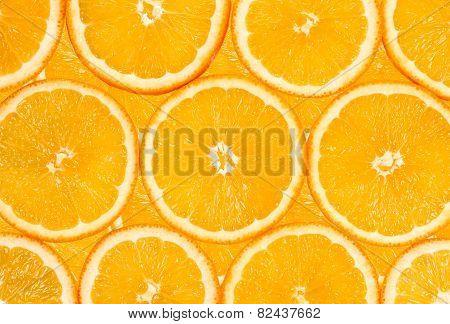 Background Of The Many Orange Fruit Slices