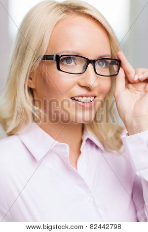 education, business,  vision and people concept - smiling businesswoman, student or secretary wearing eyeglasses in office