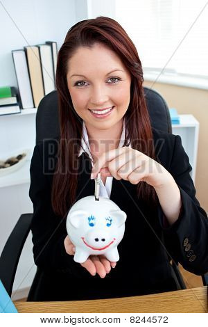 Positive Caucasian Businesswoman Holding Piggybank