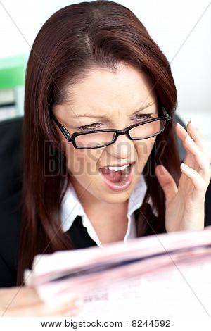 Angry Businesswoman Reading A Newspaper