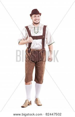 Smiling bavarian man in shirt and leather pants