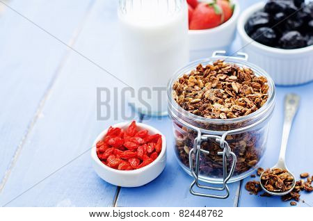 Granola With Milk, Nuts, Goji Berries And Strawberries.