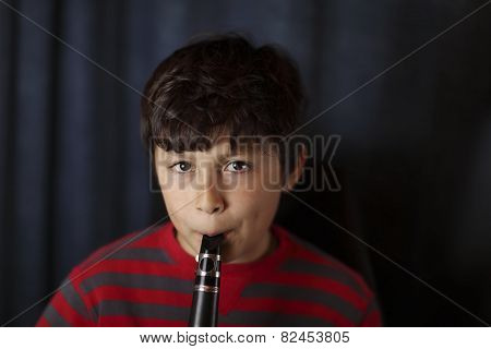 Young Boy Playing The Clarinet