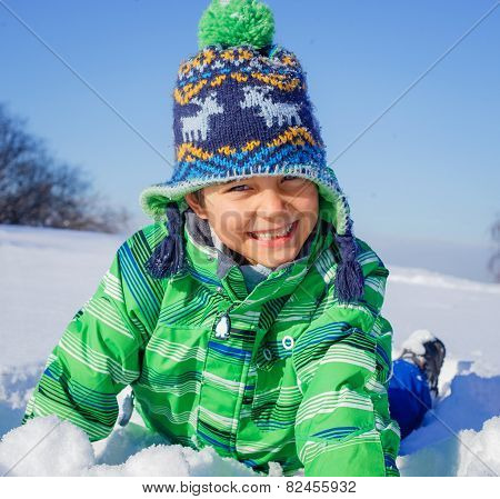 Little boy in winter park