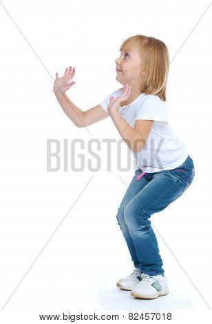 Little girl jumping hands up.