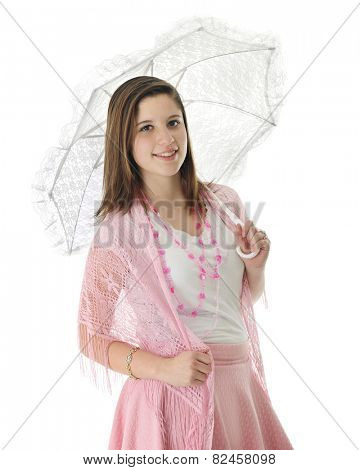 A pretty teen girl wearing strands of hearts, a pink shawl and carrying a lacy white parasol.  On a white background.