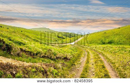 Path Through Highland Meadows At Sunrise