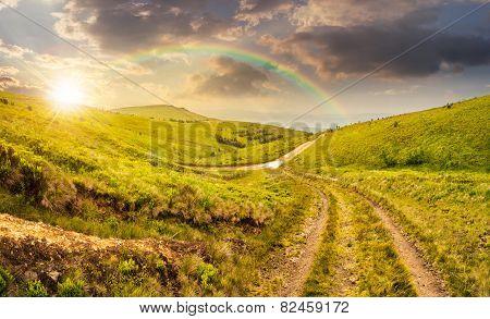 Path Through Highland Meadows At Sunset
