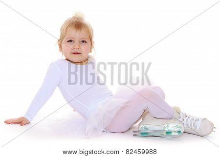 Charming little skater skates sitting on the floor.