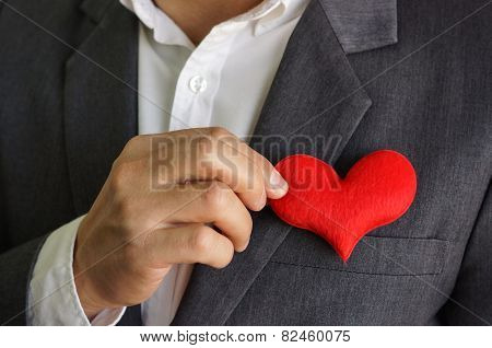 Businessman with a red heart - crm