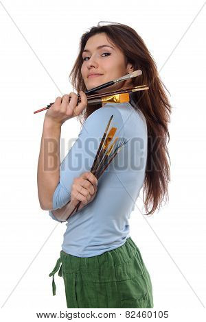 Woman Artist Holding Her Brushes In Each Hand