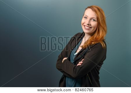 Smiling Red Haired Woman With Arms Crossed