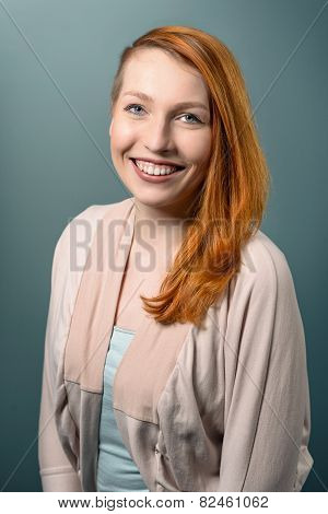 Smiling Red Haired  Woman Looking At Camera