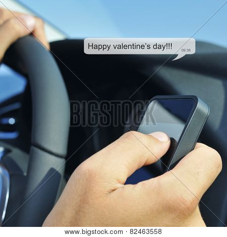 a man driving a car reads or sends the text message: happy valentines day
