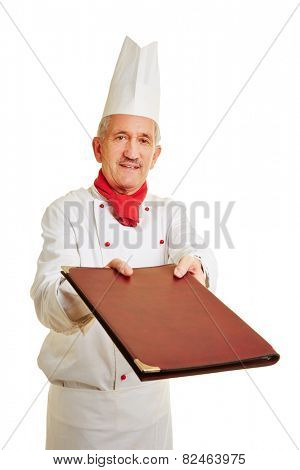 Chef cook in workwear offering menu card to a guest