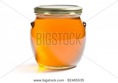 honey in a jar on white background