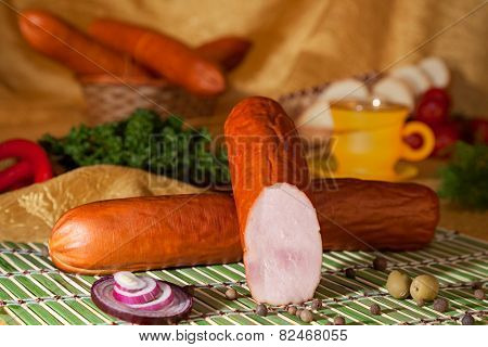 The appetizing sausage with slice