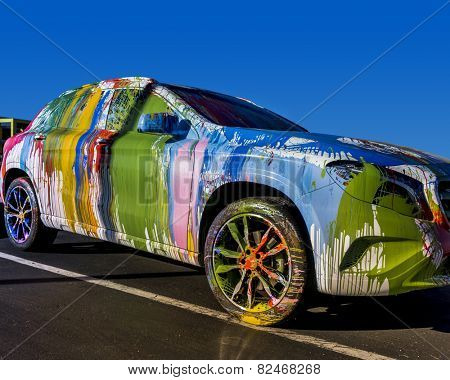 Street Art Work;  Feb, 4th,2015, Mr. Brainwash aka, famous artist Thierry Guetta, makes over a Mercedes-Benz GLA-Class at the Evolution Tour.