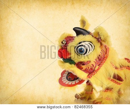 chinese traditional dancing lion on Old antique vintage paper background