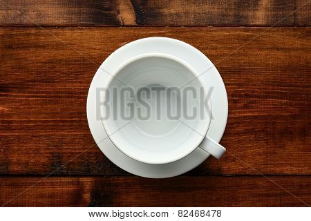 White Cup In Wood Table