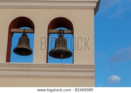 Two Bells From Church With Sky At Background