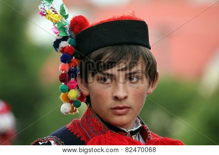 VLCNOV, CZECH REPUBLIC - MAY 26, 2013: Young man dressed in traditional Moravian folk costume performs the Recruit during the Ride of the Kings festival in Vlcnov, South Moravia, Czech Republic.