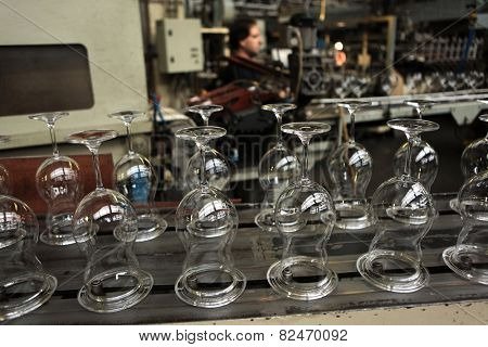 SVETLA NAD SAZAVOU, CZECH REPUBLIC - NOVEMBER 7, 2014: Automatic production of machine blown stemware at the Bohemian glass factory Crystalite Bohemia in Svetla nad Sazavou, Czech Republic.