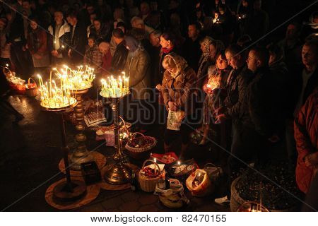 PRAGUE, CZECH REPUBLIC - MAY 5, 2013: Orthodox believers pray during an Orthodox Easter night service in front of the Dormition Church at the Olsany Cemetery in Prague, Czech Republic.