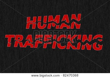 Stop human trafficking - blood red grungy words shattered and separating on dark background, conceptual image