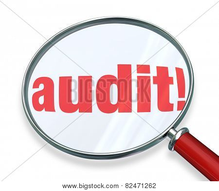 Audit word under a magnifying glass to illustrate accounting or bookkeeping rules or regulations you must follow for your home, personal or business finances