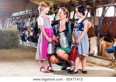Bavarian family with milk can on cow farm