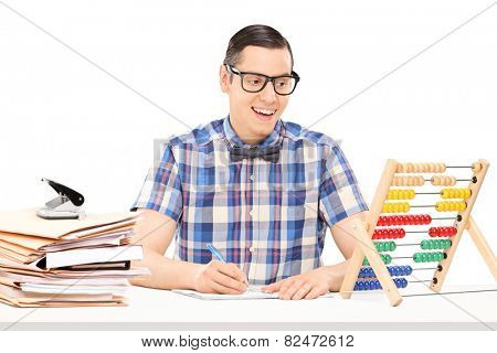 Man counting on abacus and writing down some notes isolated on white background