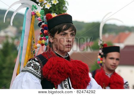 VLCNOV, CZECH REPUBLIC - MAY 26, 2013: Young man dressed in Moravian folk costume perform the Recruit during the Ride of the Kings folklore festival in Vlcnov, South Moravia, Czech Republic.